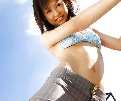 Slim asian teen babe Hara Sarasa stripping off her clothes outdoor