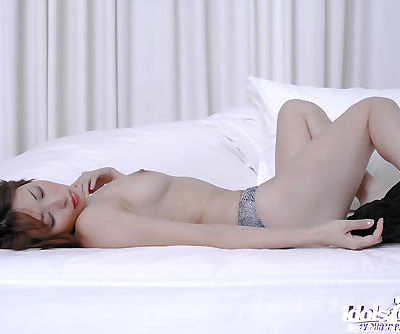 Seductive asian babe Nana Natsume stripping off her lingerie on the bed