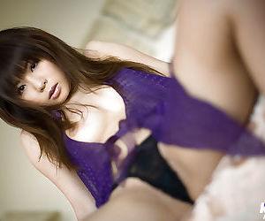 Hot asian coed Aya Hirai lowering her panties and fingering her hairy slit