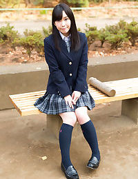 Sweet Japanese schoolgirl pulls down panties showing bare ass in the library