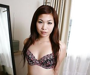 Well done asian MILF Satoko Suda slowly uncovering the brush svelte curves