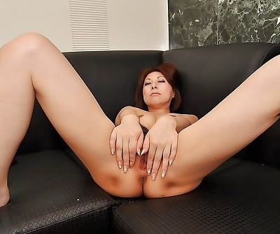 Asian MILF Norie Takahata stripping down and spreading her legs