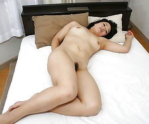 Asian demoiselle Tomoe Asai strips down and has some pussy toying and pigeon-holing fun