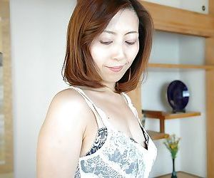 Asian MILF Shiho Tanimura undressing and toying her hairy gash