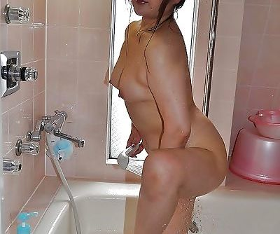 Asian MILF has some nipples tweaking and pussy fingering fun after shower