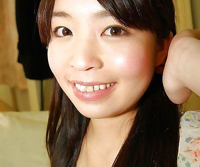 Smiley asian teen in stockings undressing and spreading her hairy pussy lips