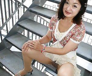 Asian MILF Chiyo Yamabe lowering the brush panties and exposing the brush hairy playtime