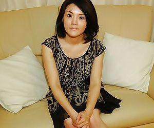 Asian MILF Saki Machida strips down and has some pussy vibing fun