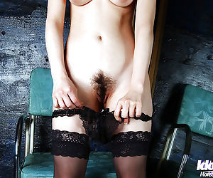 Lovely asian babe Akane Sakura posing in panties and stockings