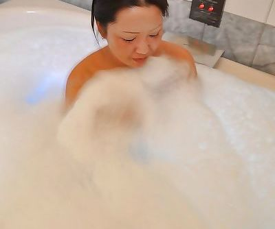 Asian MILF with shaggy cooter and shapely tits Kumiko Katsura taking bath