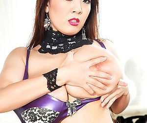 Hot Japanese madel Hitomi freeing her massive big tits and biting her nipples