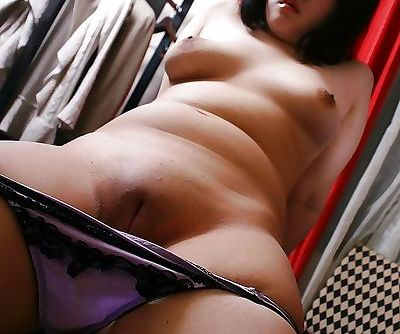 Fatty Asian MILF shows her ass in pantyhose and fingers her cunt