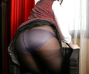 Corpulence Asian MILF shows her brim-full with pantyhose and fingers her cunt