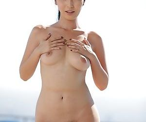 Sweet Asian chick Marica Hase bares her natural knockers and herb on a rooftop