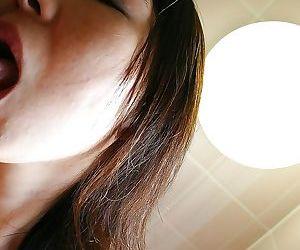 Naughty asian MILF Naho Tajiri gives a sensual blowjob in the bathroom