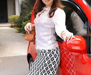 Titillating Asian Erika Hiramatsu squats momentarily skirt plus self-assertive heels outdoors