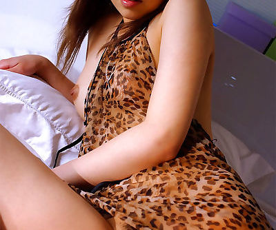 Purse Asian babe Jun upskirts her nighty for hairy pussy exposure