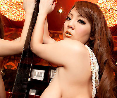 Japanese bombshell Hitomi exposing her giant breasts in front of the mirror