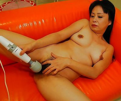 Mature asian slut gets her twat pleased with a vibrator and a stiff dick