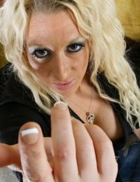 Experienced blonde lady Mickalah displaying large tits in black boots