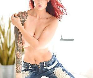 Beautiful Asian pornstar Tera Patrick releasing big round tits from bra