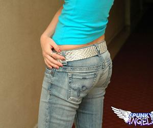 Teen solo girl strips to her brassiere in faded denim jeans