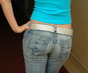 Teen peerless girl strips anent her brassiere far faded denim jeans