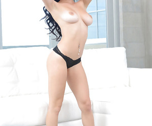 Teen babe Cyrstal Rae slipping off denim jeans and panties over phat ass