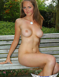 Brazen busty Kristy undressing in the park to expose big tits & shaved muff