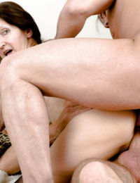 Two fuckers are drilling this nice-looking brunette in her holes