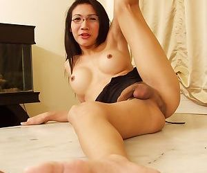 Nerdy ladyboy Tar gets rid of her sexy jeans and exposes strong cock