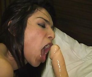 Sexy ladyboy Nam opens her legs wide & fucks herself with a giant dildo