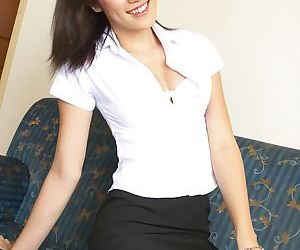 Dark haired Mosiny takes her sexy uniform off and wanks her rod