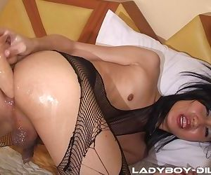 Naughty tranny in pantyhose Fang slides a huge dildo in her tight butthole