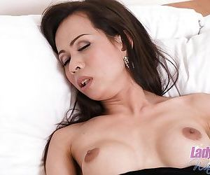 Skinny small dick Asian ladyboy Tai wanking off her cock and spreading
