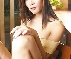 Skinny Thai tranny suddenly gets turned on and exposes small cock solo