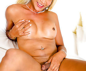 Blond ladyboy Kai is a young shemale with big tits and pierced nipples