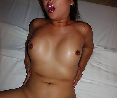 Asian tranny shows curves in improvised ring and then spreads legs for lover