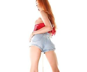 Redheaded Asian shemale For posing solo and flashing hung shecock