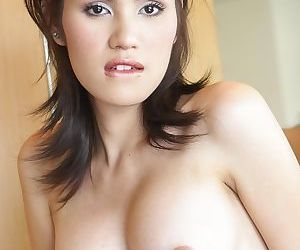 Glamour Asian ladyboy finally takes off shorts to expose small and soft cock