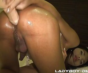 Bootylicious ladyboy Pam sliding a dildo in her tight anus before going out