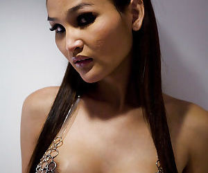 Young Asian ladyboy Paris looking sexy in bra- underwear and glasses