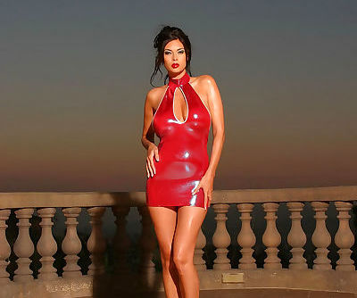 Sexy Asian pornstar Tera Patrick posing in latex dress & high heels