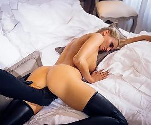 Young blonde in latex leggings takes it hard from a man wearing latex gloves