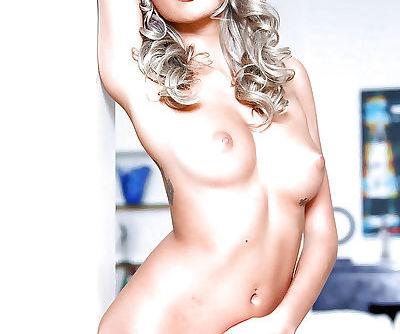 Skinny blonde pornstar Janice Griffith posing in high heels and underwear