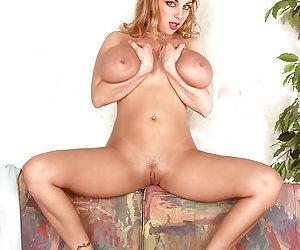 Buxom blond solo girl Autumn Jade masturbating trimmed vagina in high heels