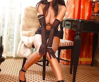 Sexy MILF Ava Adams showcasing her sexy legs and toying her twat