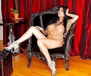 Busty Asian babe Tera Patrick displaying sexy MILF legs in high heels