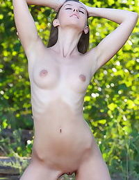 Solo girl Sybil A strips off her short summer dress for nude poses in woods