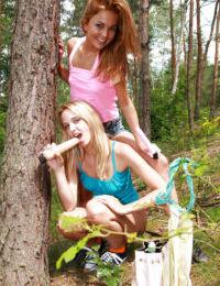 Lesbian teen Kim G teases her girlfriend outdoor in her skirt